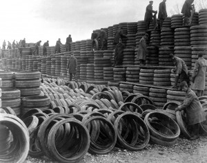 A pile of 85,000 solid tires for A.E.F. motor vehicles is one of the treasures of Langres, France.  Shows men of Motor Transport Corps, assisted by German prisoners, building up wall of rubber to greater height.  January 6, 1919.  (Army) NARA FILE #:  111-SC-44921 WAR & CONFLICT BOOK #:  588