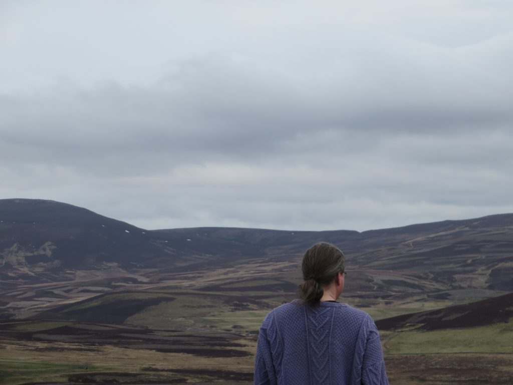Niall looking across at scottish mountains and valleys